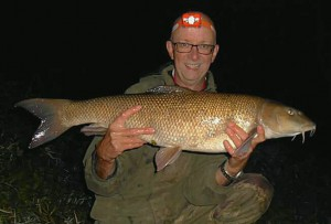 Local angler Chris Manns with the club record at 13lb 8oz
